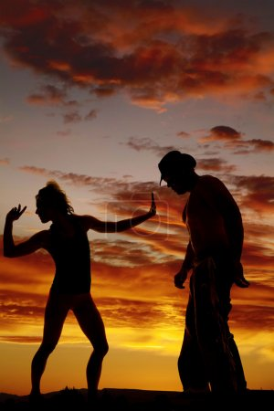 silhouette of a woman hand in front look back away from cowboy