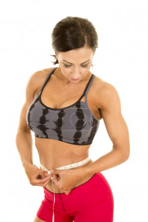 Fitness woman with tape measure