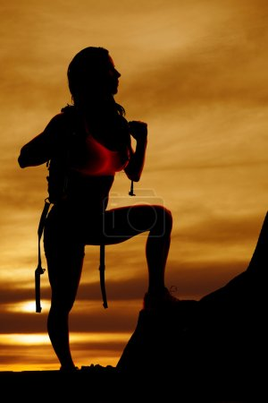 silhouette of woman backpacker