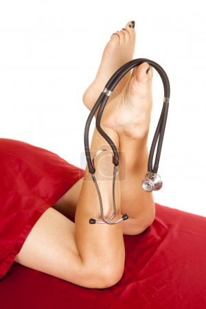 Woman legs with stethoscope