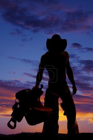 Silhouette of  cowboy with no shirt