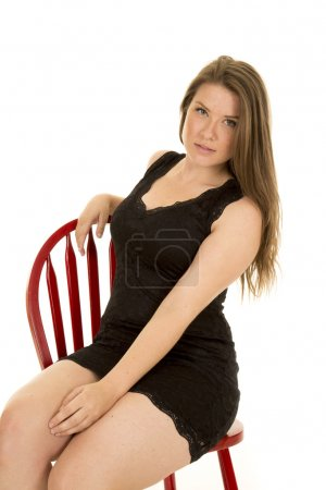 Woman sitting on a red chair