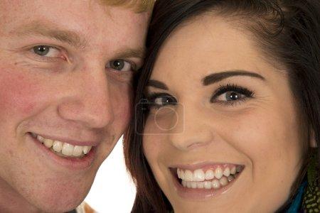 Photo pour Homme et femme tenant par la main, regardant avec de grands sourires sur leurs visages isolés sur fond blanc - image libre de droit