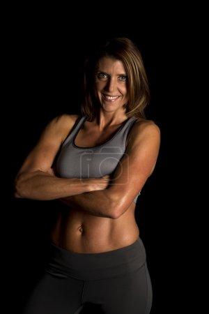 Fitness woman on black