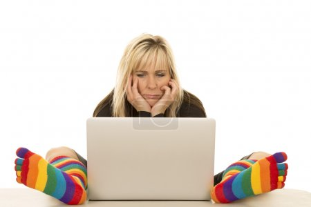 Woman in colored socks with computer