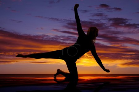 Silhouette of a woman doing a yoga