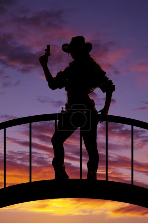 Silhouette of cowgirl outdoors