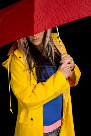 Woman with umbrella in yellow jacket