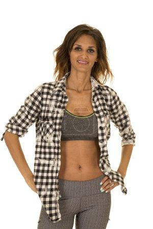 Sport woman in checkered shirt