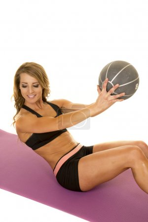 Fit woman with ball