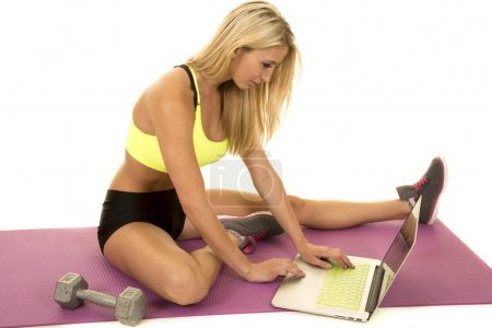 young fit sporty woman with laptop