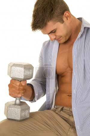 strong man holding dumbbell