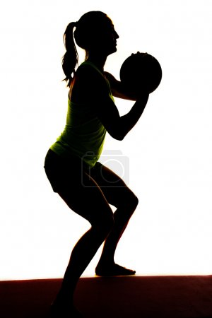 Silhouette of woman with ball