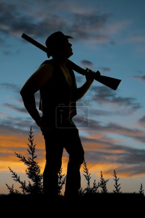 silhouette of cowboy with shotgun