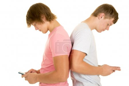 two boys back to back both texting