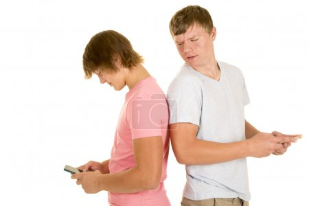 Two boys back to back text one look over shoulder