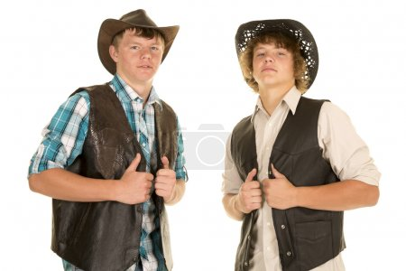 two young cowboys hold vests