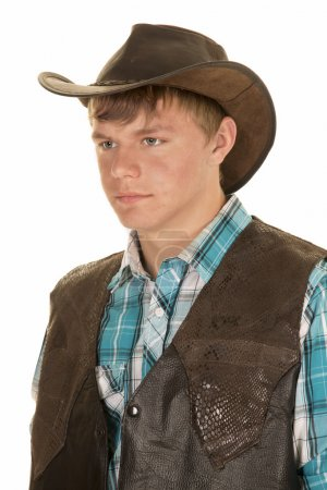 young cowboy in vest look side close