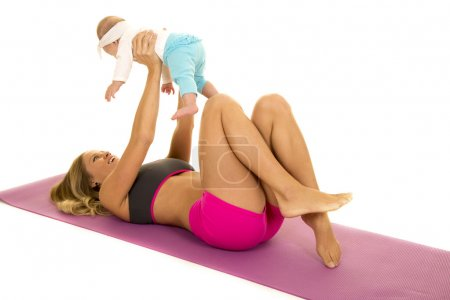 woman on fitness mat with baby