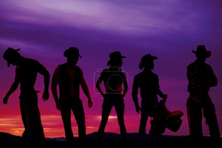 silhouette of cowboys in sunset