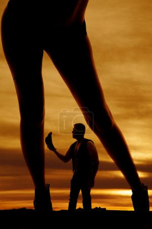 silhouette of a woman in bikini bottoms legs lean to side over c