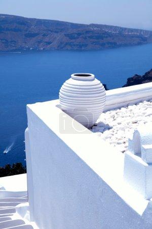 white greek pot on white terrace, Oia, Santorini, Cyclades, Gree
