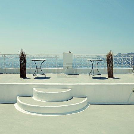 white terrace overlooking sea in Oia, Santorini