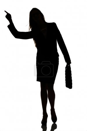 Silhouette of a busy business woman backlight studio