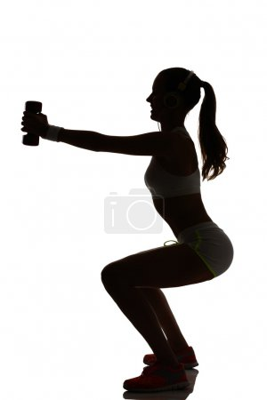 One woman exercising fitness workout lunges crouching weight tra