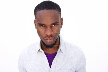 Young african man staring at camera