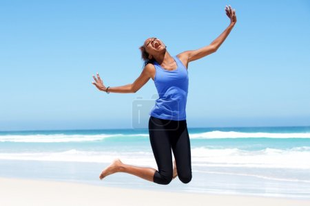 Young african woman jumping