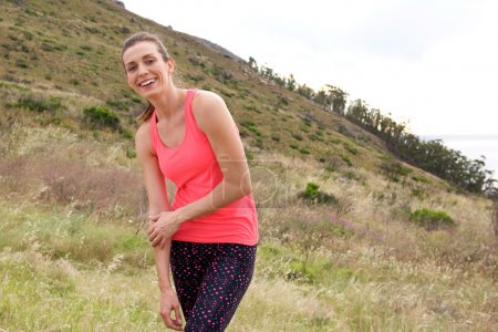 Sports woman smiling outdoors