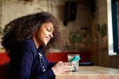 Smiling young lady relaxing in a coffee shop