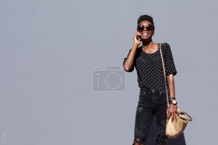 Trendy african lady talking on mobile phone