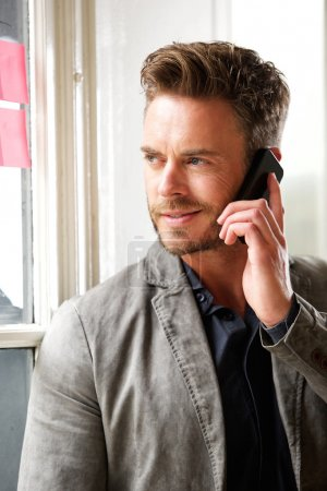 Attractive business man on telephone call