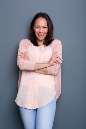 Asian woman smiling with arms crossed