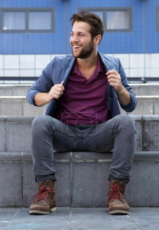 Photo for Portrait of a cool guy sitting outside on steps - Royalty Free Image