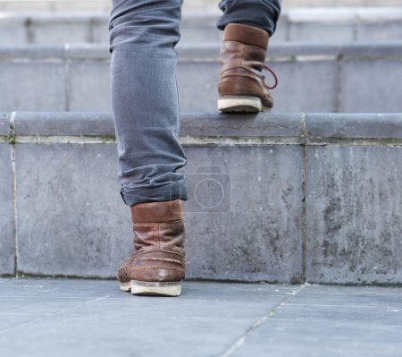 Photo for Close up low angle man walking up steps - Royalty Free Image