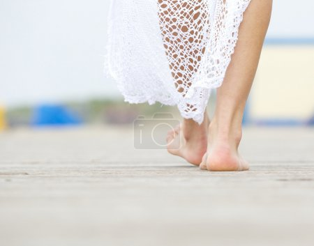 Rear view close up female walking barefoot