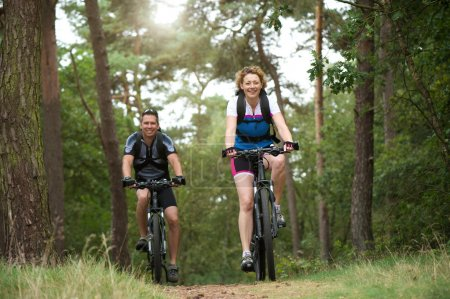 Photo for Portrait of a happy couple enjoying a bike ride outdoors - Royalty Free Image
