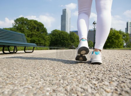 Woman walking in city park