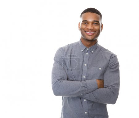Photo pour Portrait of a modern young black man smiling with arms crossed on isolated white background - image libre de droit