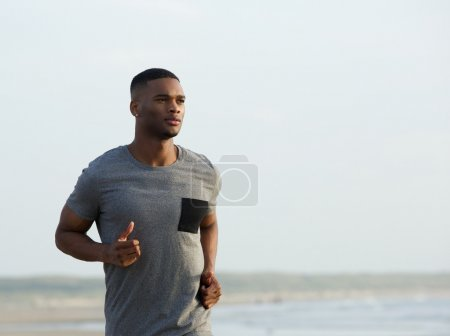 African american man running outdoors