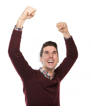 Happy man cheering with arms raised