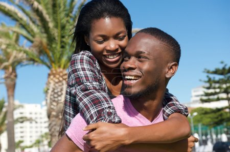 Photo for Close up portrait of a happy young couple laughing together outdoors - Royalty Free Image