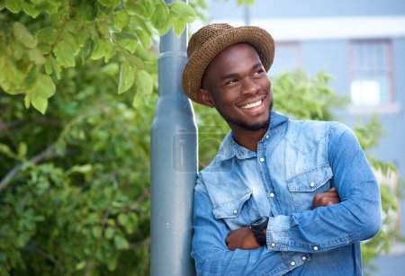 Photo for Close up portrait of an attractive young man smiling with arms crossed - Royalty Free Image