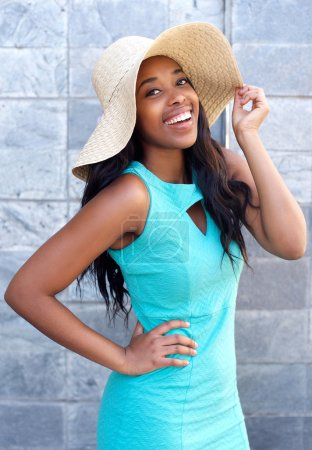 Beautiful african american woman smiling with sun hat