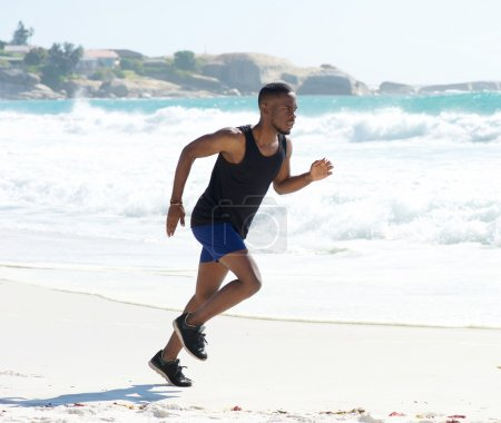 Fitness man running on the beach
