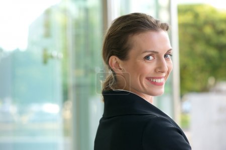 Career woman smiling outside