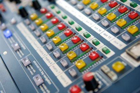 Buttons and knobs on audio mixer